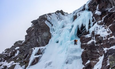 moving underneath the icicle fringe to the cave belay
