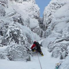 Heading up to the last belay before the crux chimney pitch of glovers chimney, Ben Nevis