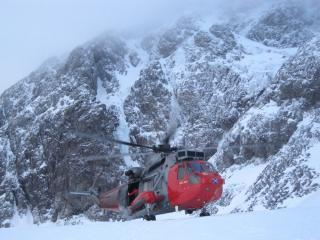 Sea King drops into Coire na Ciste for a rescue; Tower Ridge behind.