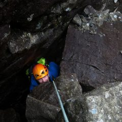 Jonny coming out of the second, less interesting, hole in the upper part of Eastern Gully.