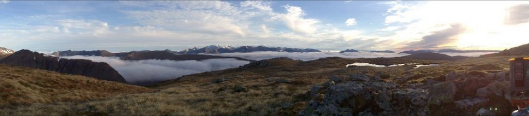 Getting ready for a bivvy on buachaille etive mor as sun starts to set and glencoe fills with mist below!