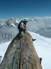 Robin atop s face aiguille du midi on beautiful blue sky day with paula and ode