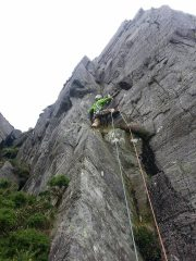 John Roberts trying to avoid the muddy ledge (stick to the rock) on Zip Groove, Carreg Mianog