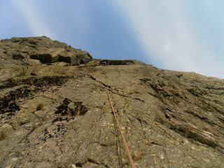 Tony Womersley approaching the roof of Whit's End Direct on a blustery day