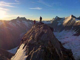 Ascending the Mittellegi ridge on the Eiger with the Schreckhorn behind