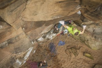 Pete Gunn pulling through the crux sequence of The Exorcist, Armathwaite.
