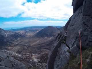 Rhys enjoying the exposed traverse pitch on Labyrinth.