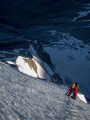 Climber high on the Arete Mettrier, Domes de Miage., 108 kb