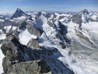 Zinalrothorn. SE Ridge, Matterhorn and Dent Blanche
