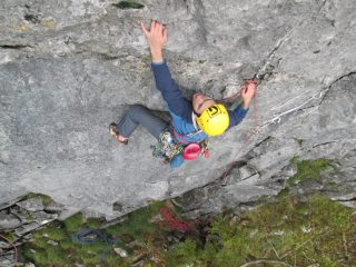 Reaching through the overhang, on Overdose at Pot Scar