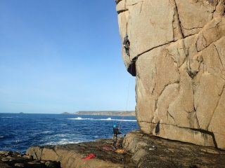 Henry just past the crux on Samson Arete