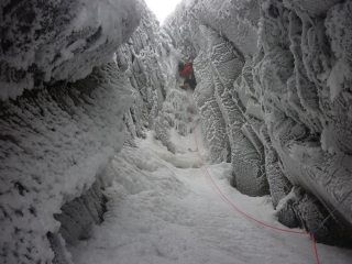 Me leading top pitch in very lean conditions.  Couple hard moved to get out of here when its this lean.