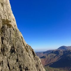 Emily cruising up Asterisk on Gimmer's lower North-West face on the best day of the year