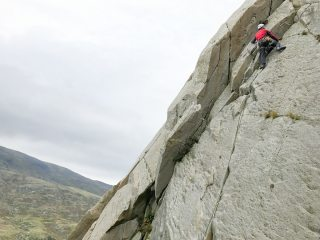 Leading the first pitch on Direct Route (Milestone Buttress)