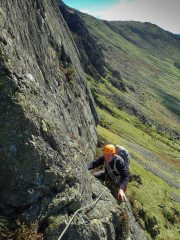 Jim moving up to the belay at the end of pitch 2