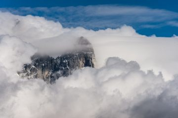 The Aiguille du Dru visible in the clouds above Chamonix, France. It disappeared from view not long after., 110 kb