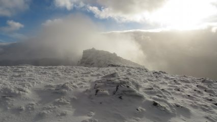 Approaching the summit as the clouds break