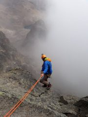 Abseiling into the mist from the summit of Point John in Mt Kenya National park