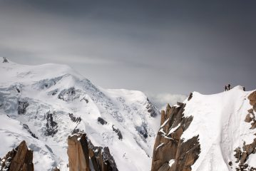 Climbers shake hands after the Cosmiques arete, 185 kb