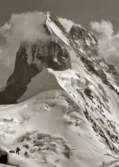 Man and Mountain. Descent from peak Schurovskogo with Ushba Grandeur view on background. Elbrus region.  Caucasus., 84 kb