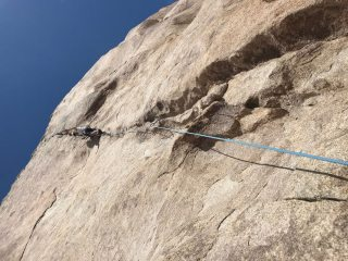 Halfway up the first pitch. This climb was hard to find in the desert!