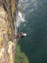 Abseiling Castell Helen sea cliff.