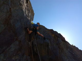 Erik Button working through the crux sequence on Rift Wall