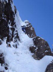Compression Cracks, Ben Nevis. Climber Malcolm Bass. Photo Neil Adams.