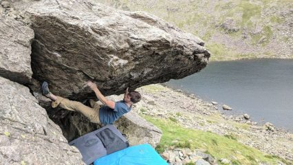 Me doing supergene up on the Dow Crag Boulders