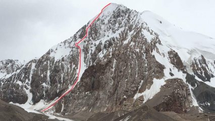 North East Face of Pik 5044. Robbie's Revenge marked in red.