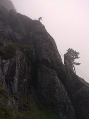 Abseiling off the route as stormy weather rolled in