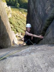 Kelly at the top of Great Chimney (left hand crack)