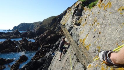 Thomas Falla seconding Wet on Sunset Slab at Le Gouffre, Guernsey