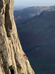 Unknown climber on Gimmer Crag in evening light.