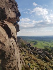 Climbing Sauls crack HVS 5a at the Roaches with Rob