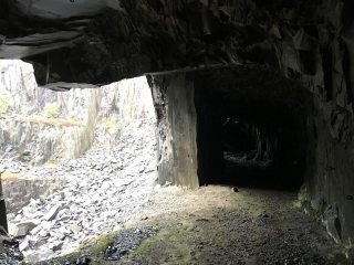 Tunnel at top of Wall Within showing abseil bolts