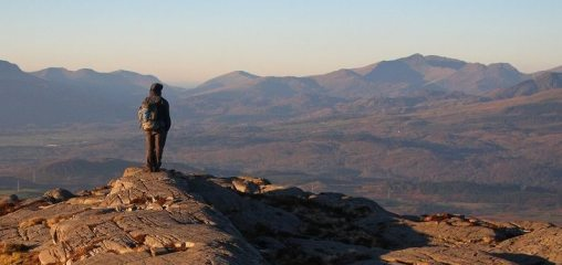 Aled Williams on top of Foel Penolau with Snowdon in the background, 68 kb