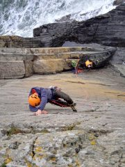 Scott Ruse on the finishing moves of White Wall, Caerfai Bay, North Pembroke.
