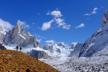 Jack Parsons and Bill Ward walking into Polacos camp across seemingly never ending moraine, beneath Cerro Torre.