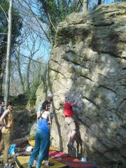 Tony Leeworthy working the Tractor Traverse (f6C+) below Apex Problem on a lovely spring day in the woods