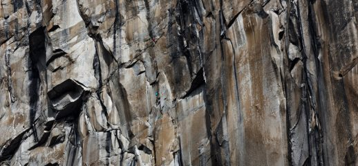 Unknown climber hauling on the upper West side of El Cap, (possible Muir Wall???), CA