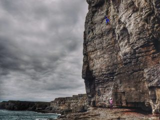 Michael Robinson enjoying the moody setting and steep climbing at St Govans.