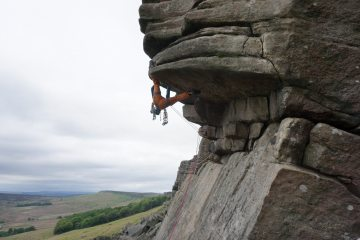 Faffing with a cam placement while attempting Flying Buttress Direct