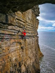 Ben setting a premature belay on Exposure Explosion at Ogmore.