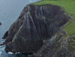 Spot the climbers. First ascent of An Bronntanas E2 4a,4c,5a Glaneragh Co Kerry