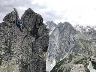 Matt Grange on the final abseil after completing the NE Ridge via Dente Per Dente