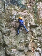 Owain Hassall on the first ascent (seconding) Owain Glyndŵr, VD at Bailey Quarry