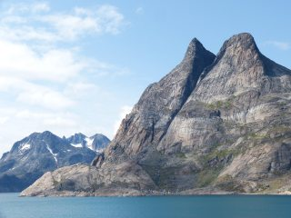 South Greenland, In Prince Christian Sound, the village of Aappilattoq just visible beneath an unknown mountain.