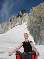 Arron worshiping the sun under the cosmiques hut