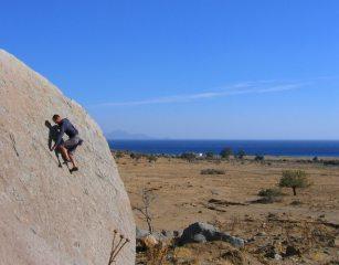 Gordie Lees bouldering on a very windy day in Kos